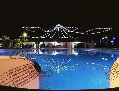 Jardines luna noche piscina